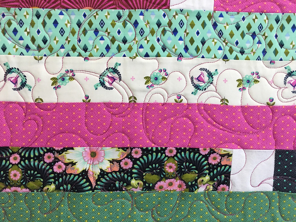 Hearts Quilting Pattern on Colorful Jelly Roll Quilt by Marian Loep