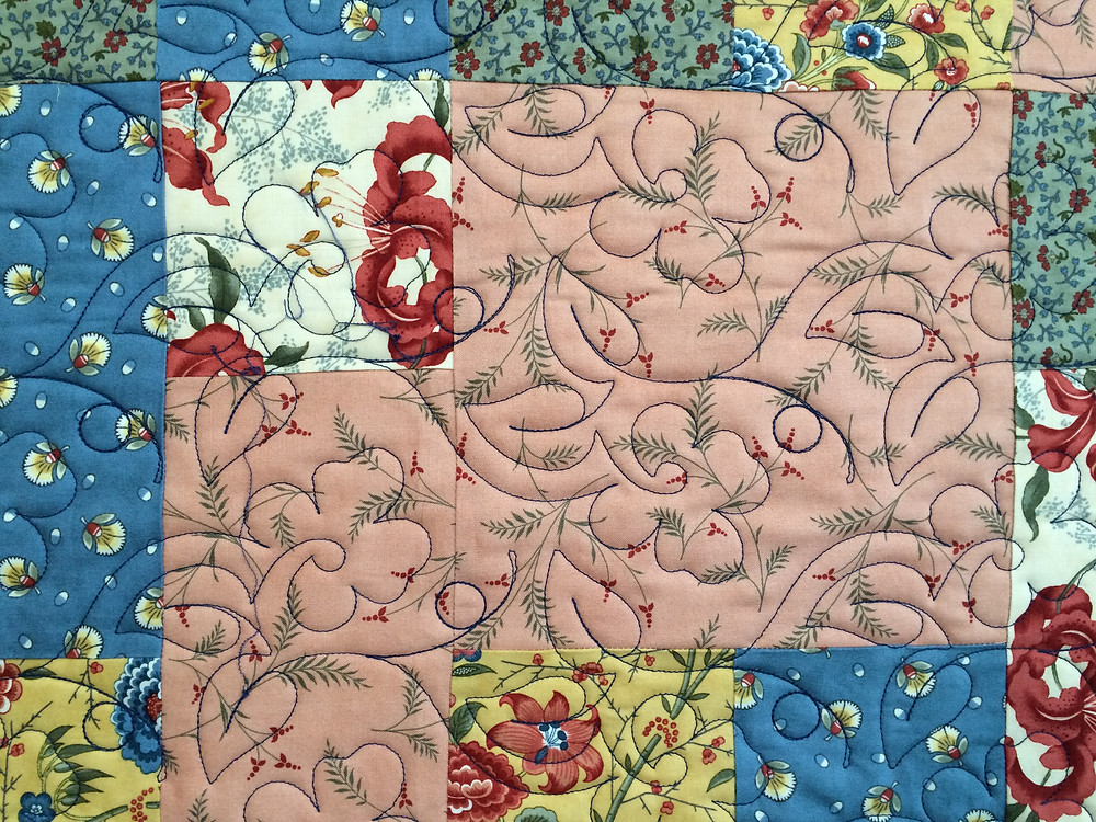 closeup of Toni Rocha Red Flowers Quilt