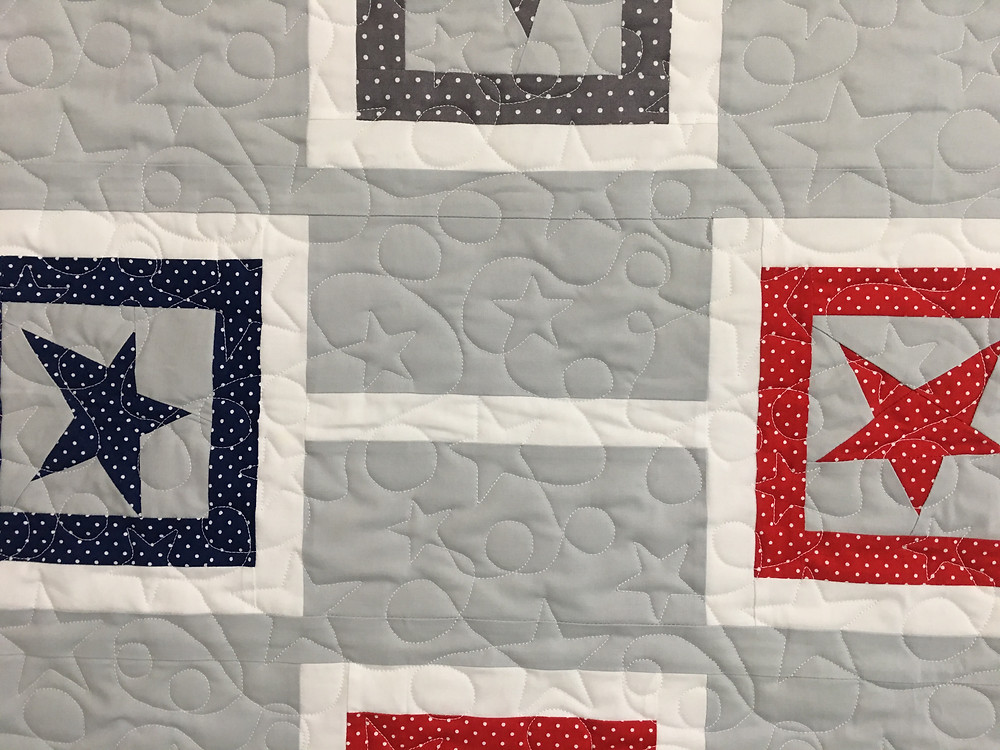 Star quilting pattern on Chain Reaction Buggy Barn Stars Quilt by Mary Dewlen