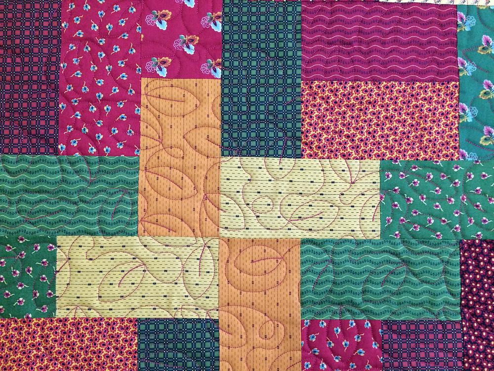 Closeup of Janne Osborne Multi Color quilt