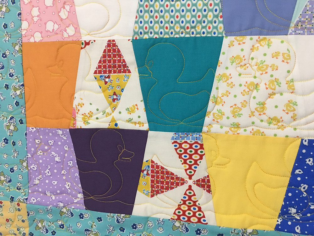 Duck Quilting Pattern on Tumbler Block Baby Quilt by Cindy Lovelace