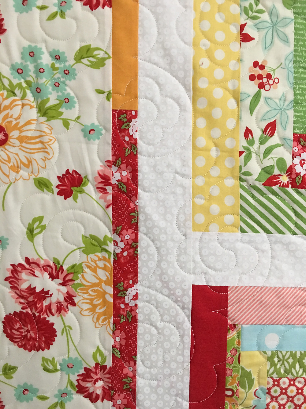 close up of Deb Scrappy Christmas Quilt with quilting