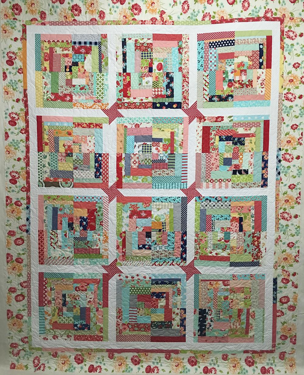 Deb Scrappy Christmas Block quilt in bright colors