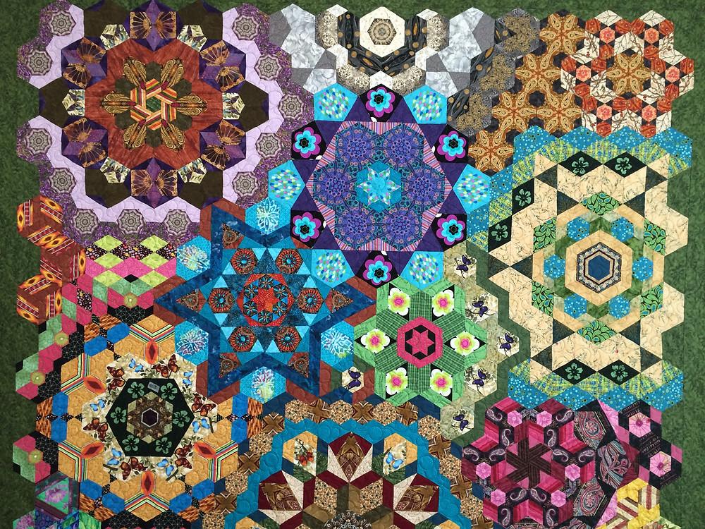 closeup of Anita Mester Hand Pieced Hexagon Millefiori Quilt