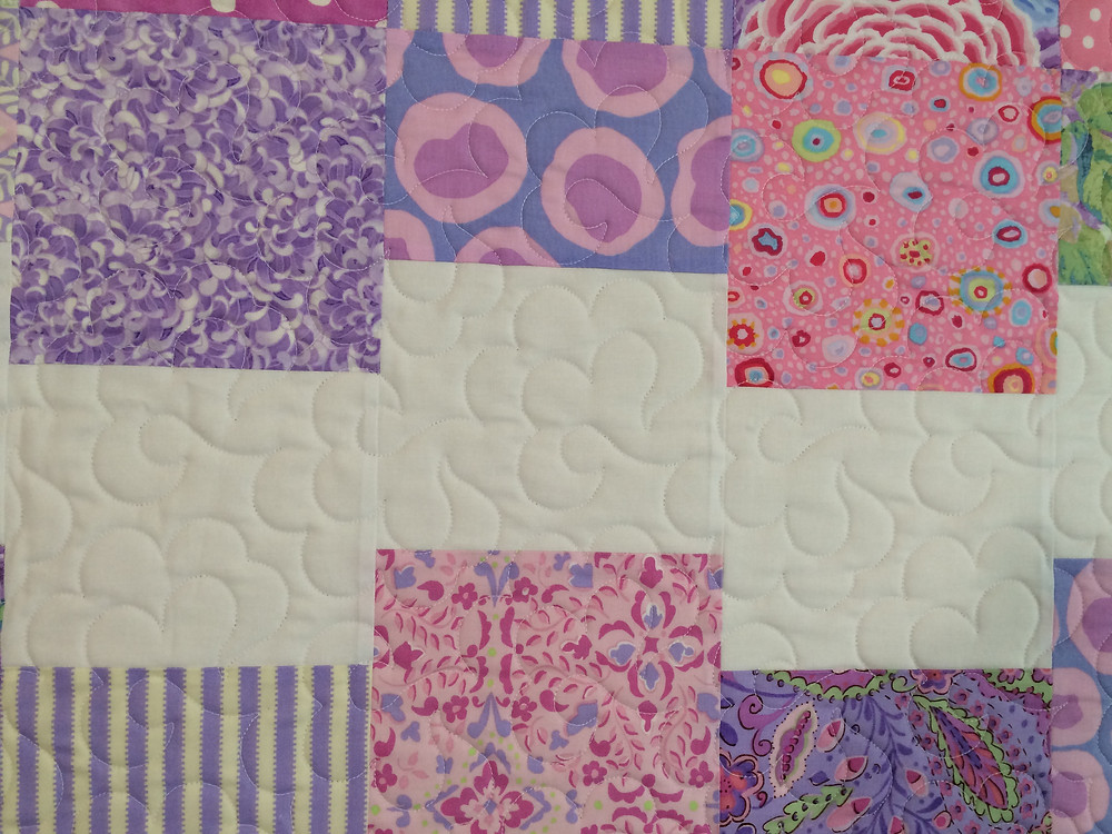closeup of cloud 9 quilt in spring color prints