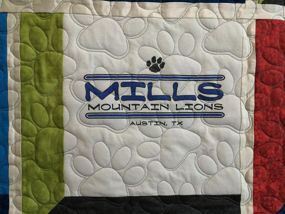 closeup of school t-shirt quilt for mountain lions