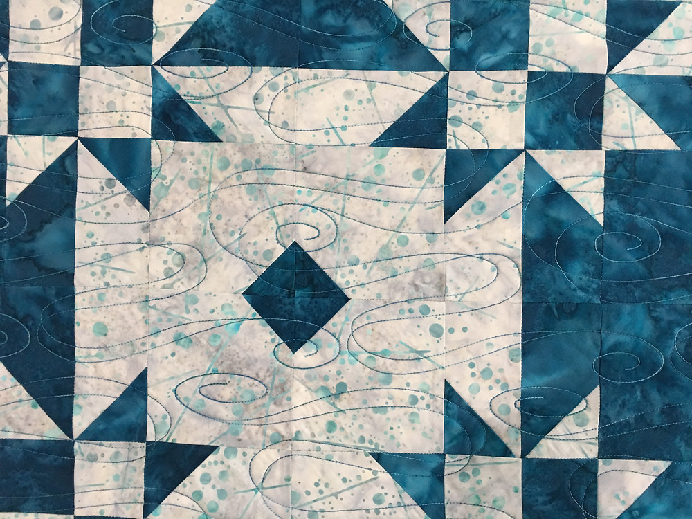 Swirls quilting pattern on Blue and White Stars Quilt by Linda Betncourt