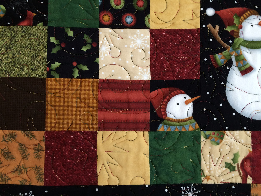 close up of Leslie St. Onge Christmas Quilt in Flannel