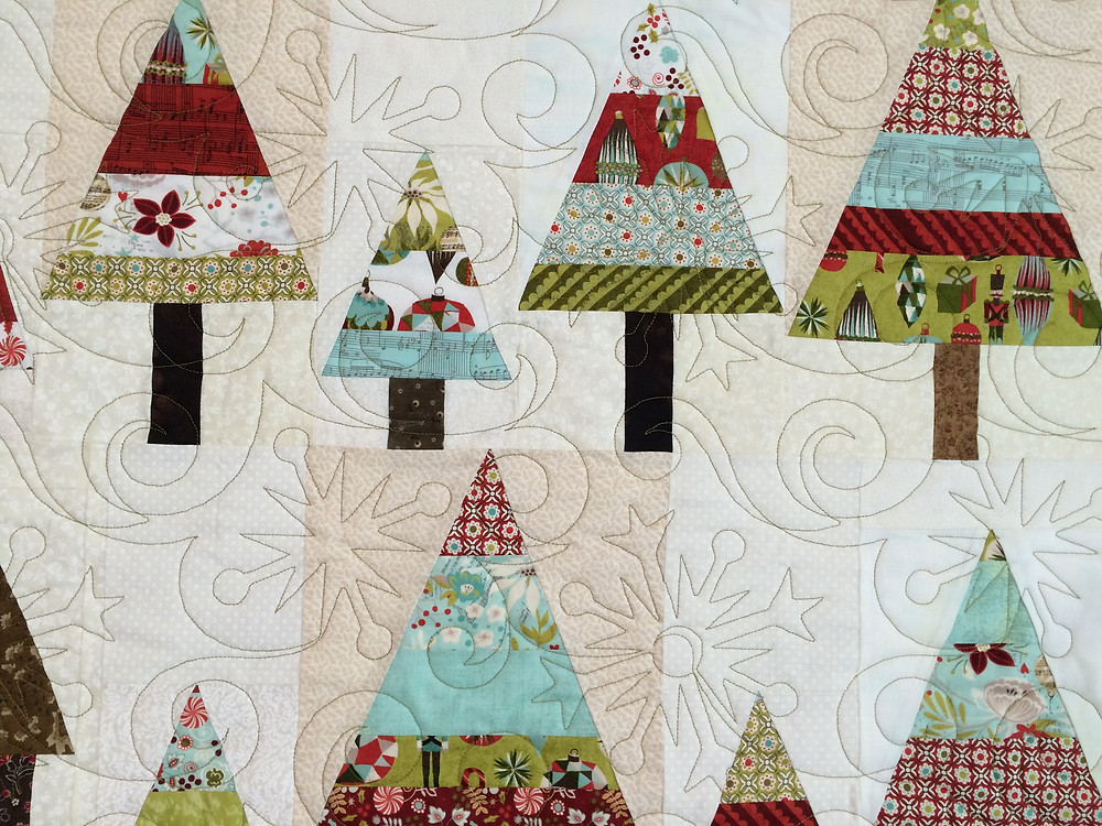 close up of Jill Seward's Holiday Trees and House quilt