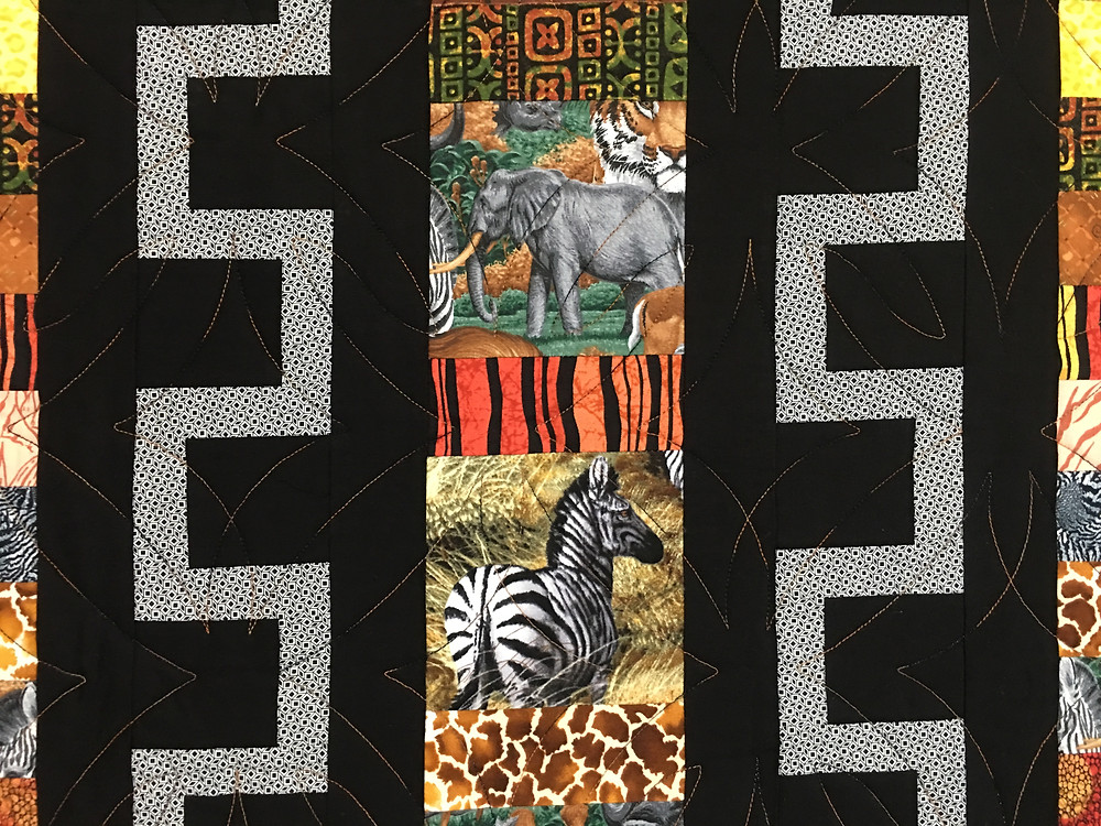 Geometric Quilting Pattern on Out of Africa Quilt by Elon Webber