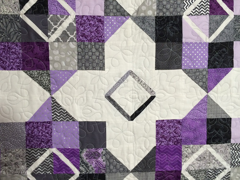 closeup of floating block in purples grays and white
