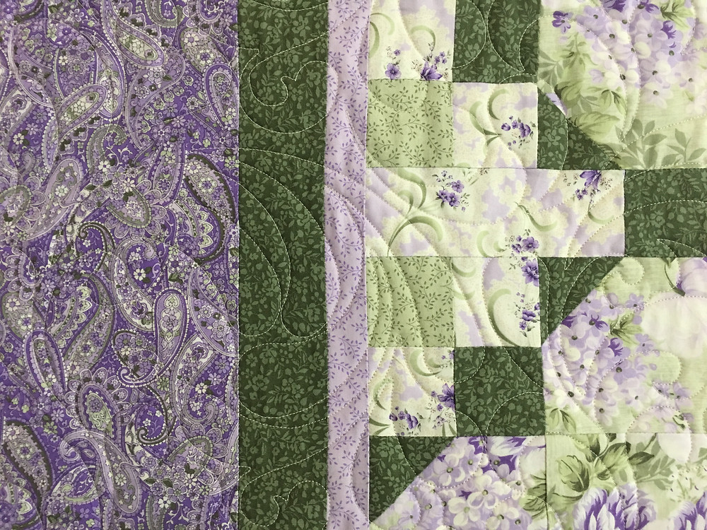 Feathers Quilting Pattern on Purple Paisley Quilt by Chris Olsen