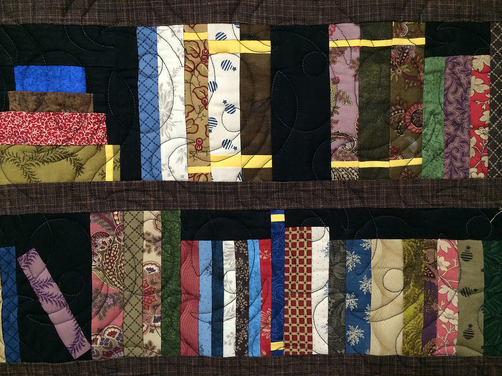 bookshelf quilt with curved quilting