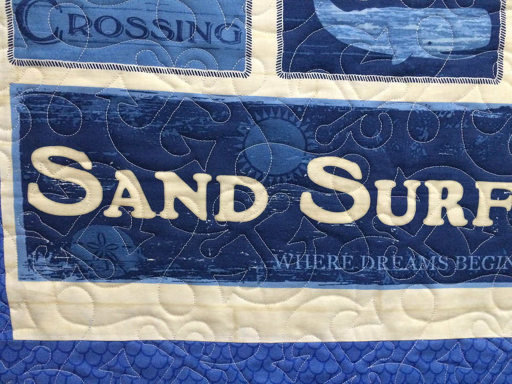 closeup of Beth beach quilt with anchor stitching design