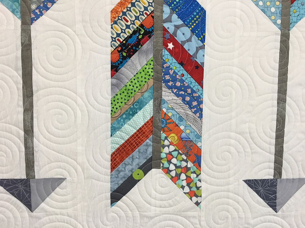 Circles Quilting Pattern on Arrow Baby Quilt by Andi Hays