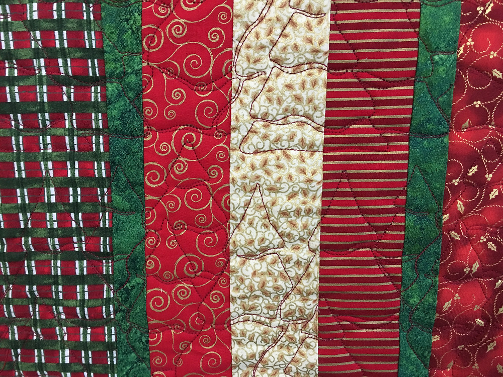Christmas Trees Quilting pattern on Christmas Reds and Green Quilt by Laura Wetzel