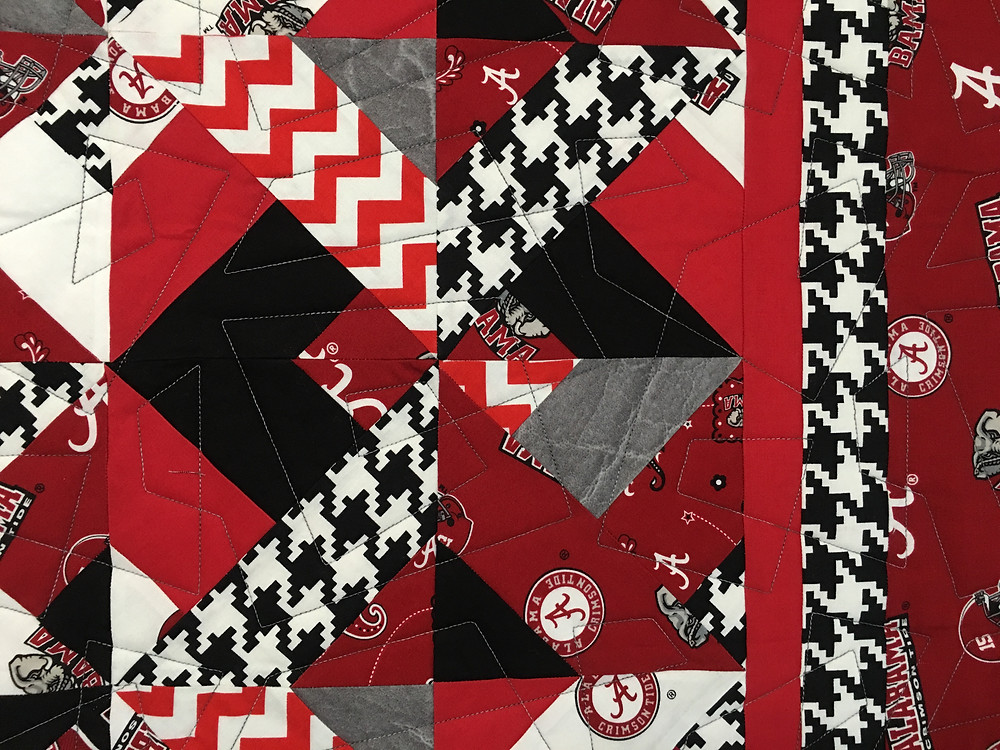 Geometric quilting pattern on University of Alabama Quilt by Mary Derryberry