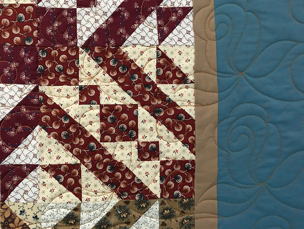 close up of quilting pattern FR1031 Roses on Sue Merrit's quilt