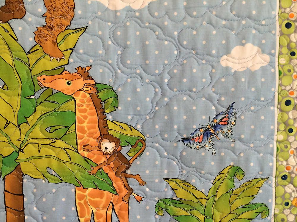 another closeup of Jeri Couthen Animals at Play Quilt