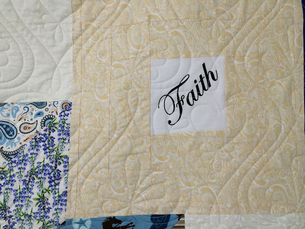 closeup faith panel on rippling star quilt