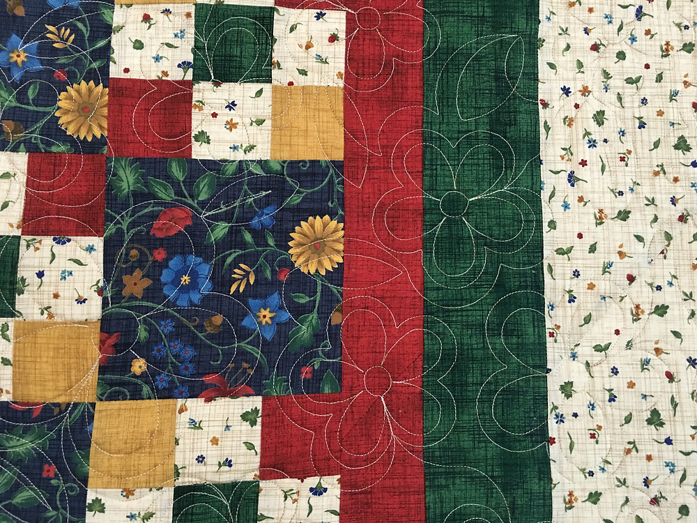 quilting design of flowers on Sandra Mitchell's quilt