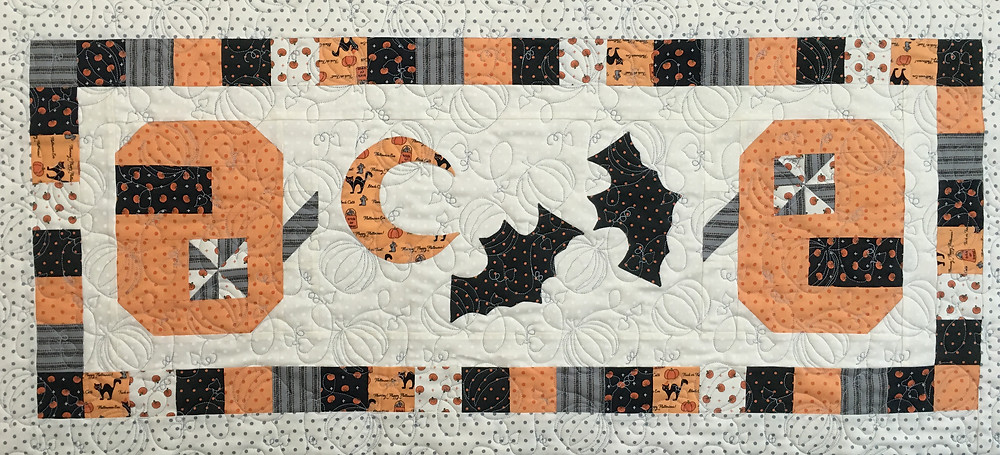 Dancing Pumpkins Table Runner by Delfina Guerra