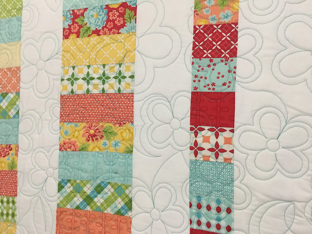 Flowers Quilting pattern on Jelly Roll Quilt by Debbie Seitz