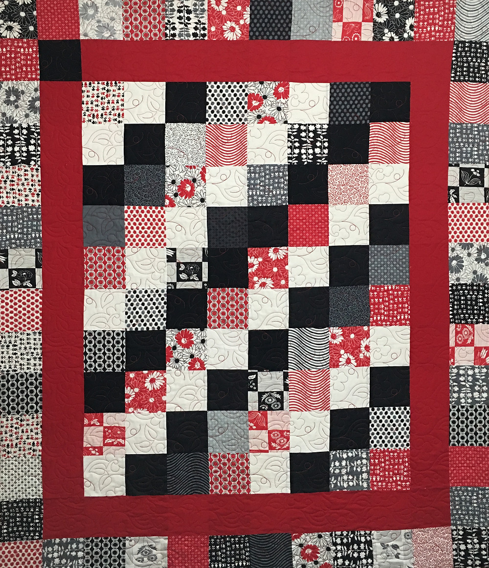 Red and Black Charm Pack Quilt by Wendy Bell