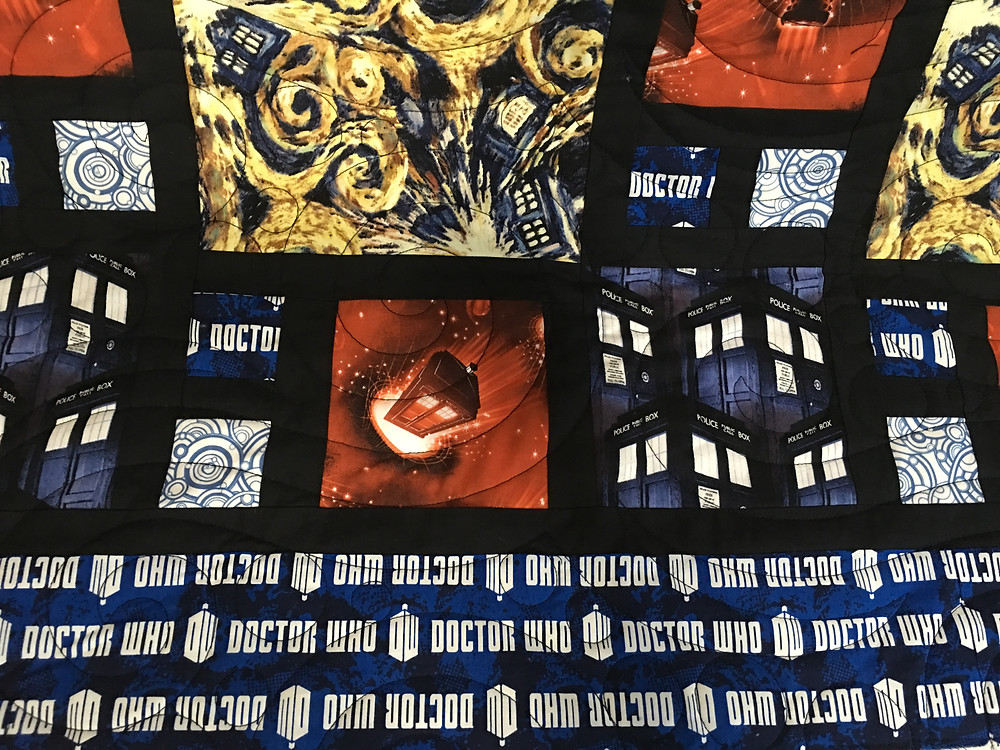 another closeup of Jamie Dr Who Quilt with sea foam qulting