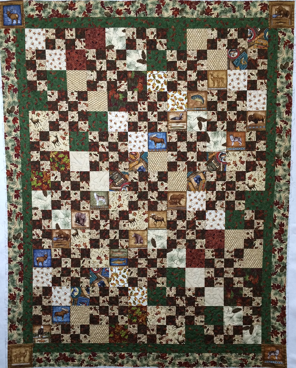 country lodge quilt with animal motifs
