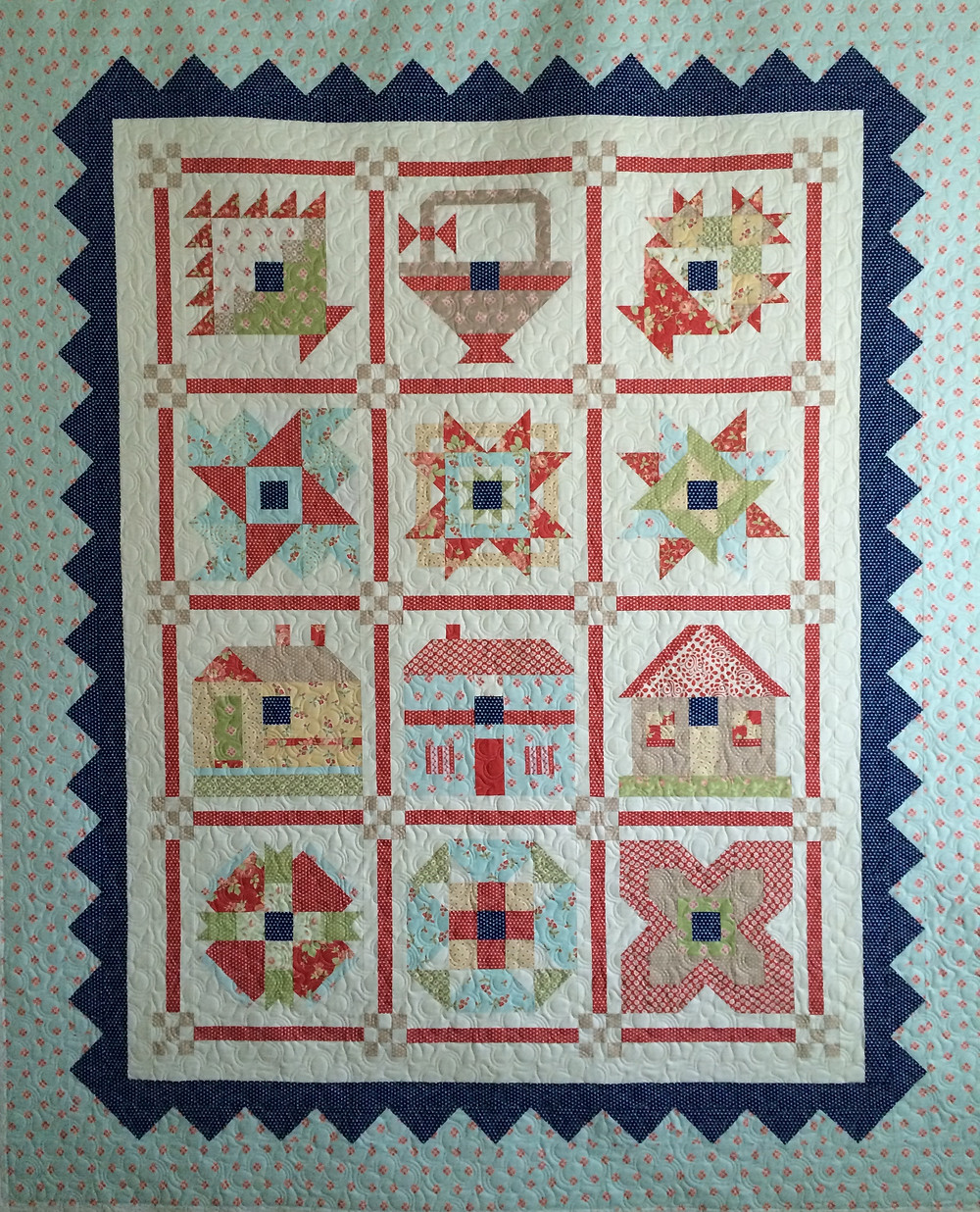 sampler quilt with nine patch cornerstones in shades of soft blue