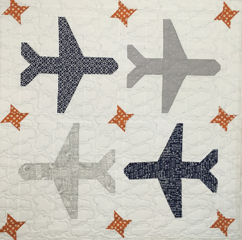 Baby quilt with airplanes by Jocelyn Robinson