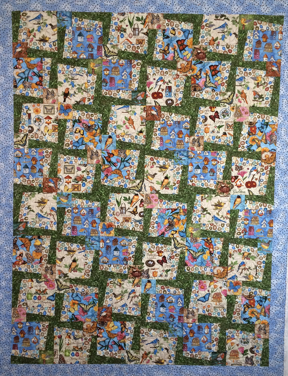 bird and butterfly prints in asymmetrical block quilt