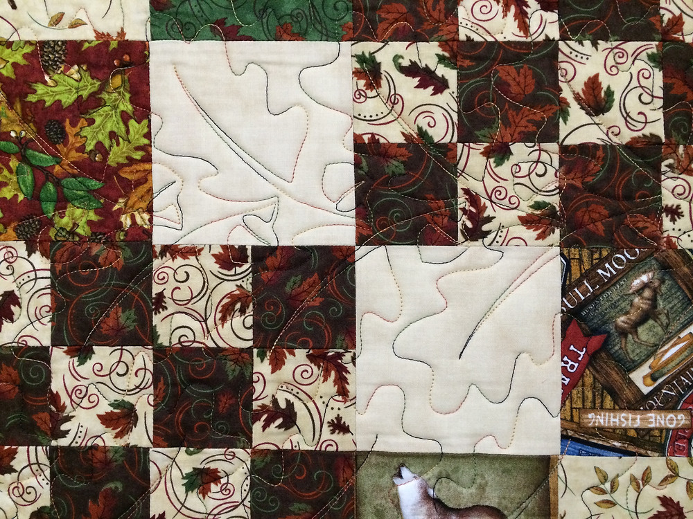 closeup of leaves and acorns on country lodge quilt