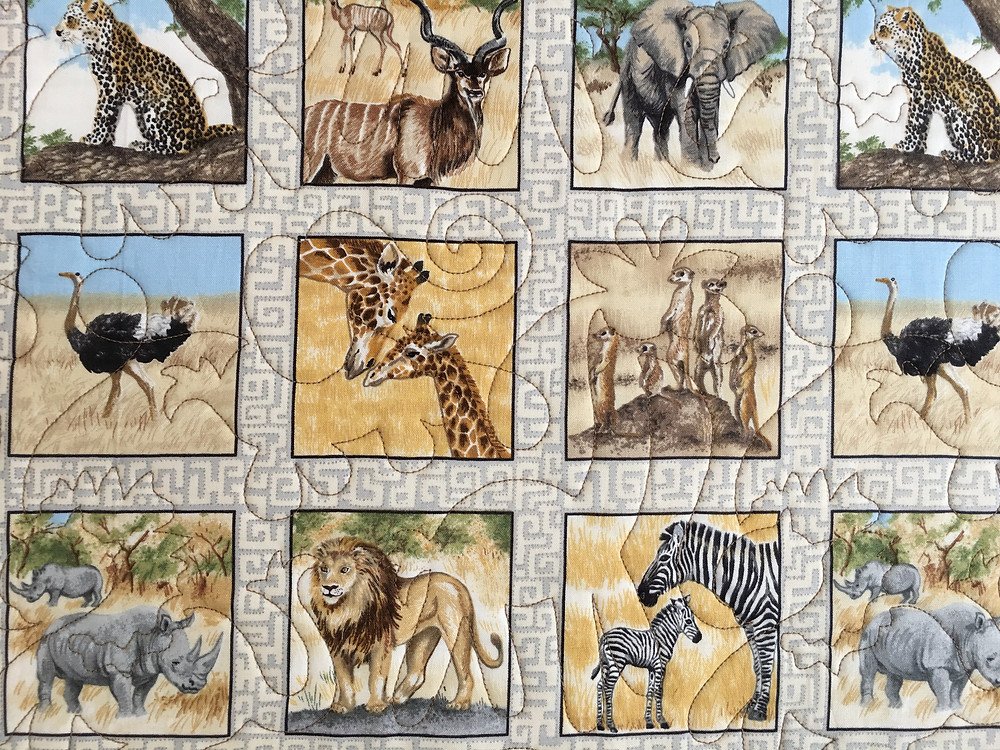 Animal Quilting Pattern on Animal Baby Quilt by Teri Chavira