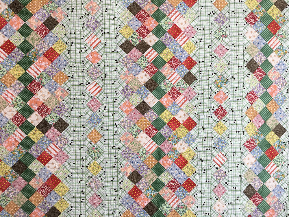 Closeup up of 2 inch squares in Stepping Stones quilt by Chris Olsen