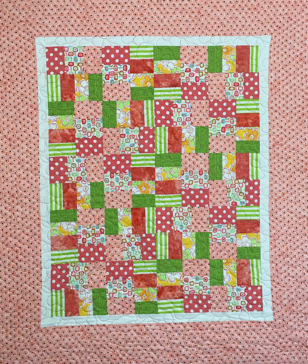 Laura's baby quilt in pinks and greens fabrics