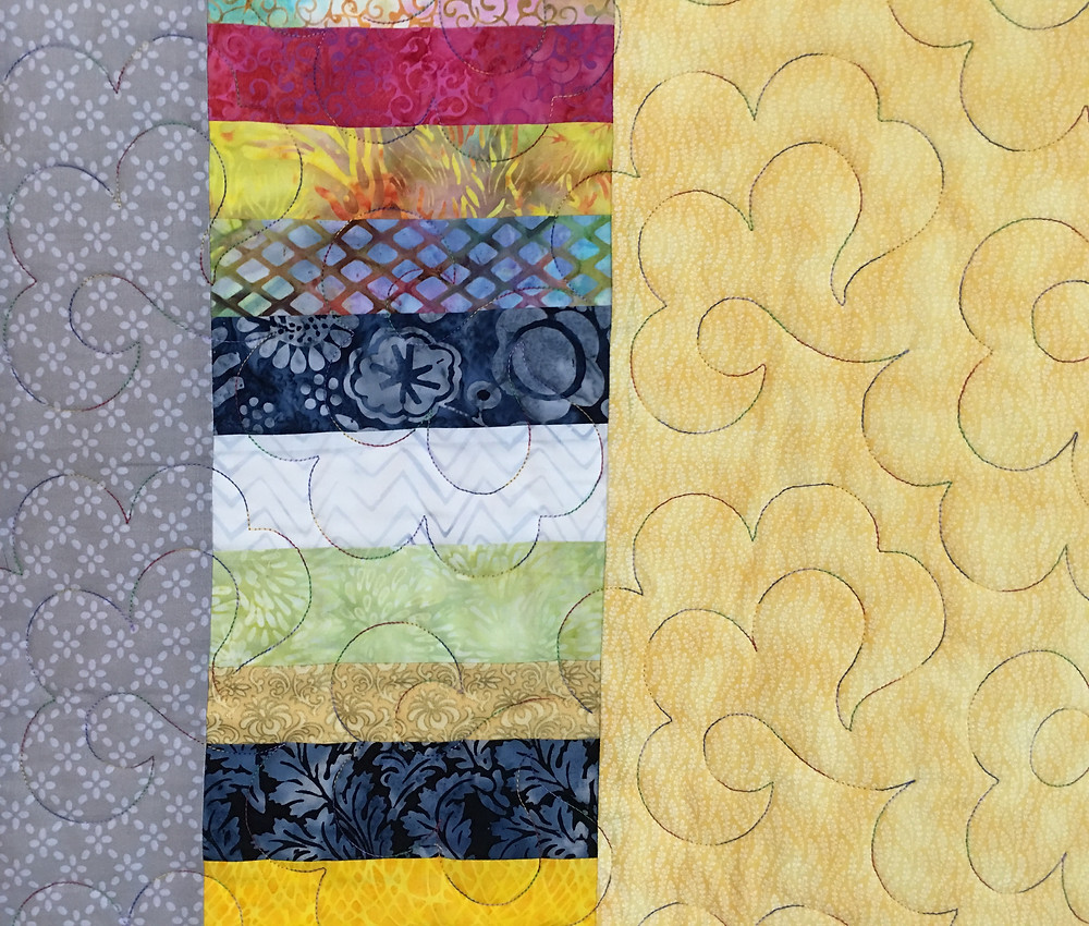Quilting design on the tiny triangles quilt by Rose Dillon