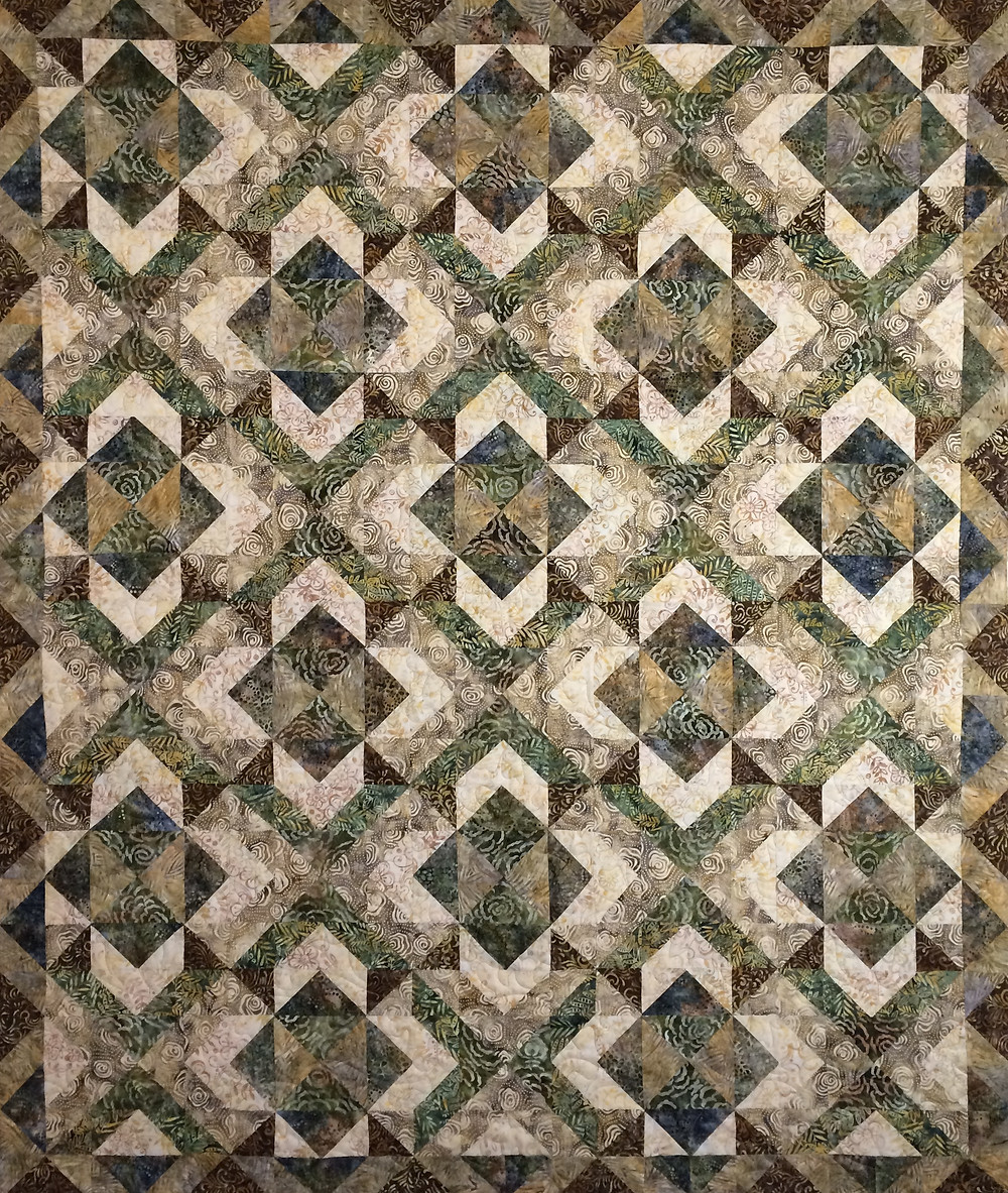 Cynthia Parra's green and brown batiks quilt