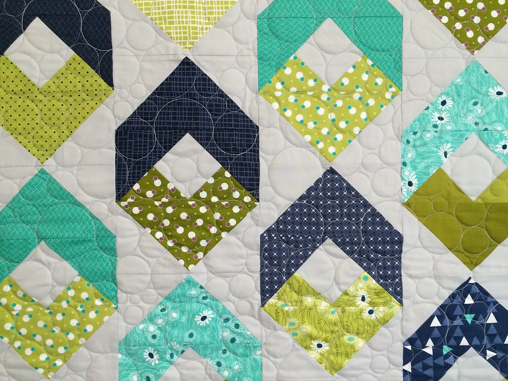 closeup of flying geese with shadows displaying circles quilting