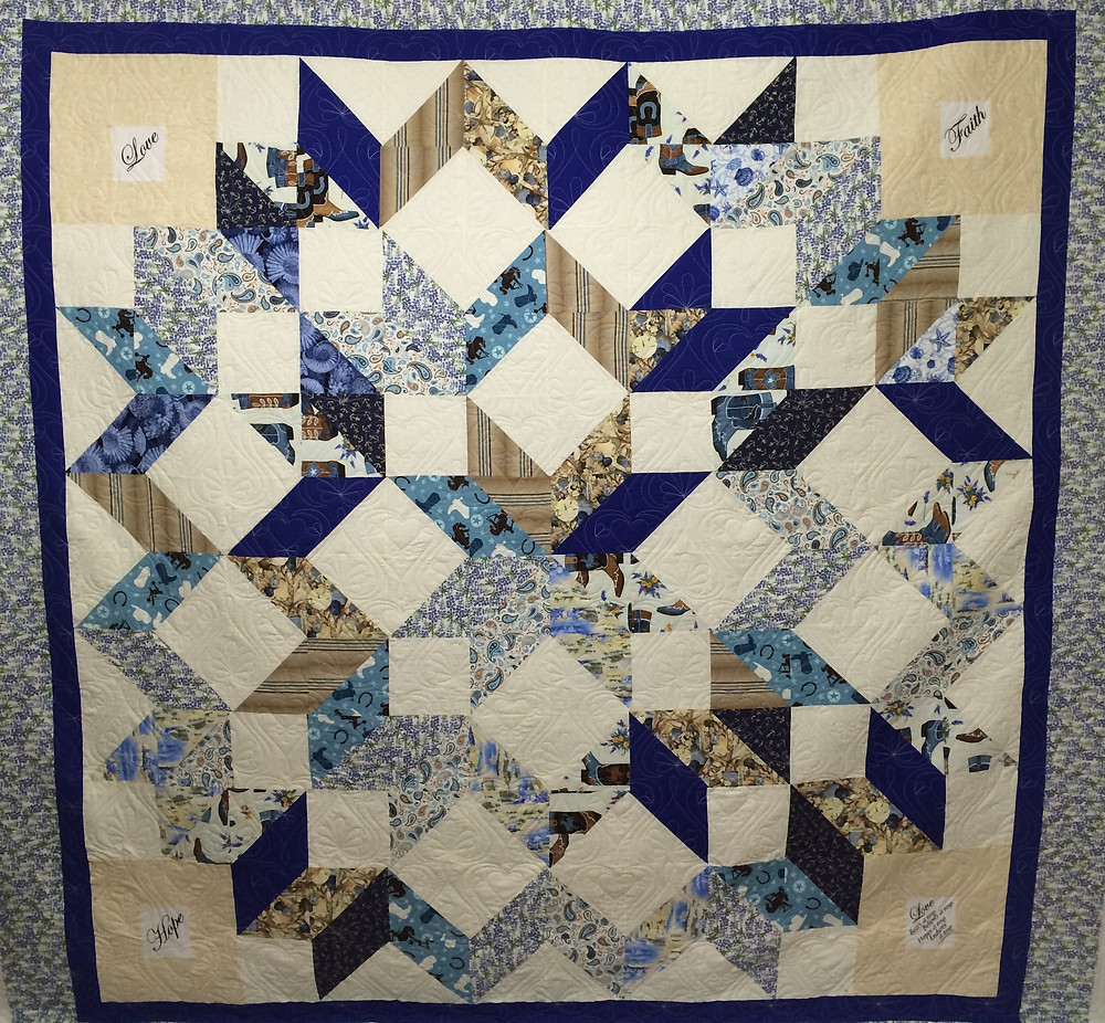 rippling star quilt in shades of blue and white