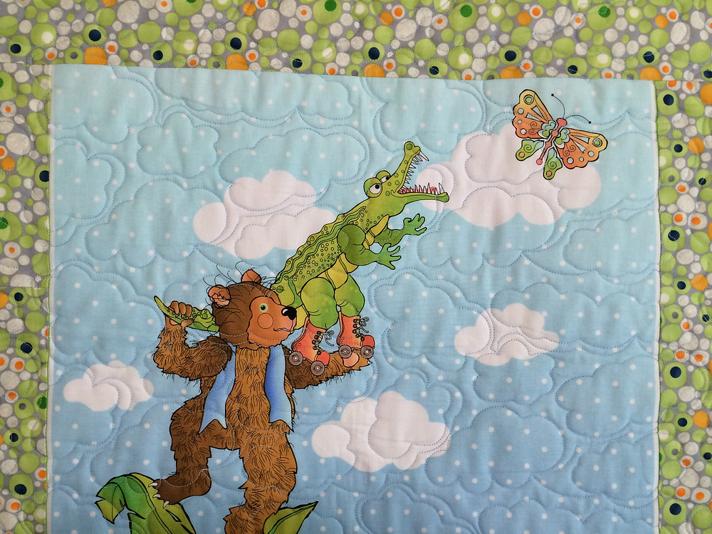 closeup of Jeri Couthen Animals at Play quilt