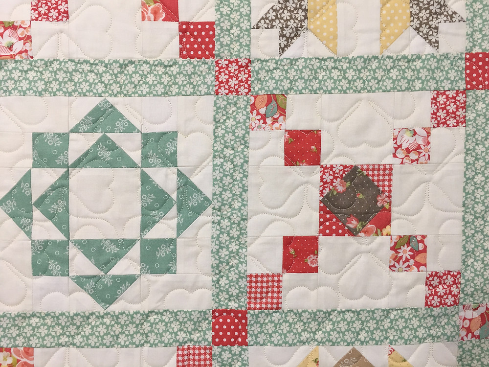 Flower quilting pattern on Country Houses by Deb Taylor