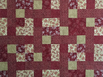 Linda Maker Red and Gold Quilt