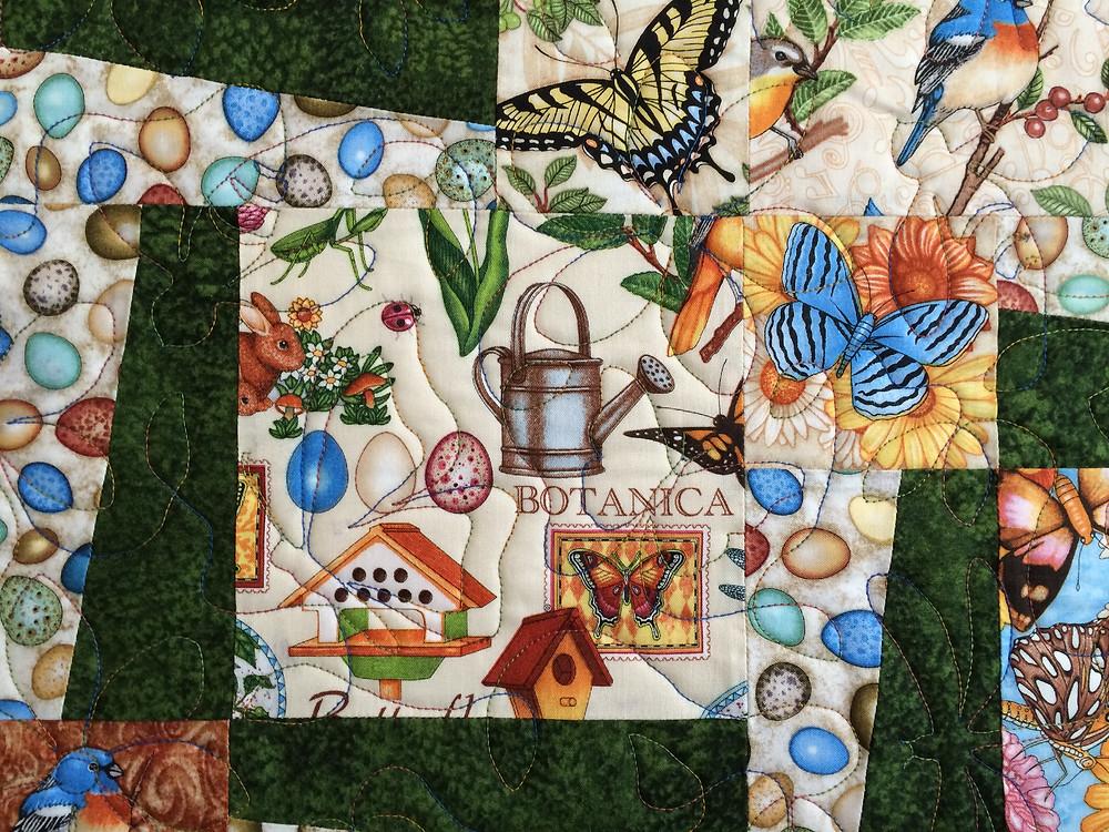 Closeup of Leslie St.Onge Birds and Butterflies Quilt