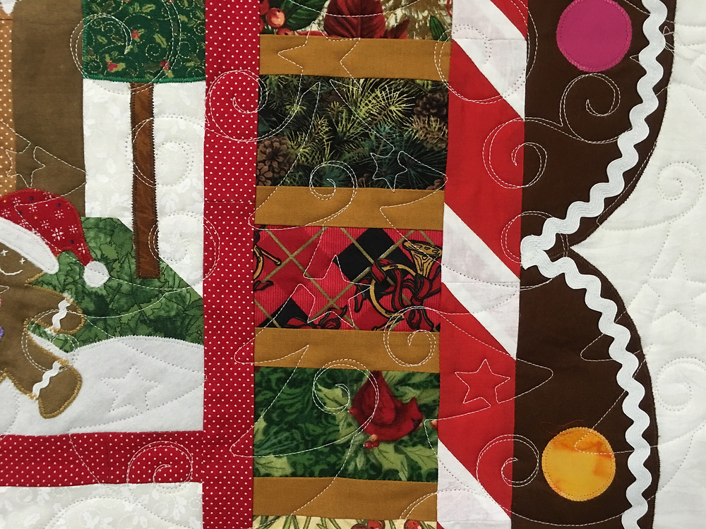 Christmas Tree quilting pattern on Gingerbread Village Quilt by Liz Zoch