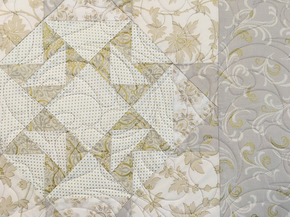 quilting pattern of feathers on the 50th Anniversary Quilt by Debbie Seitz