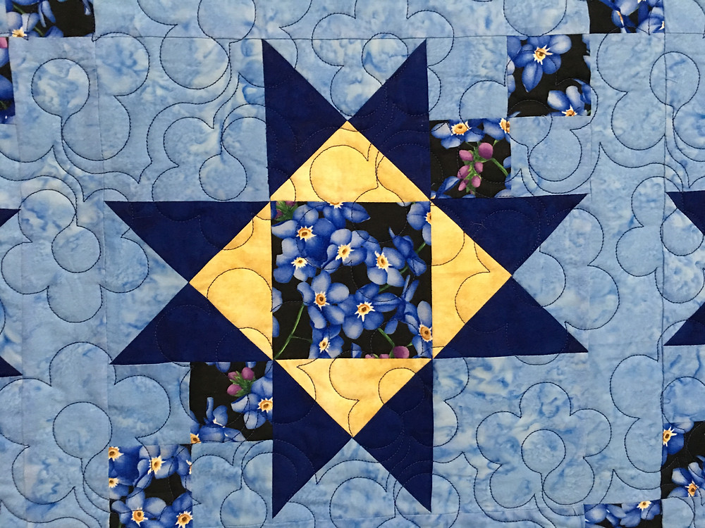 close up of quilting pattern on Dorothy Griffith Forget Me Not Quilt
