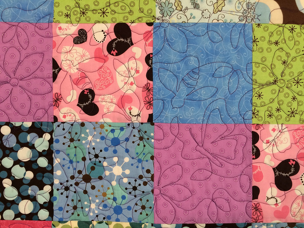 close up of Toni Rocha Multi Square Block quilt