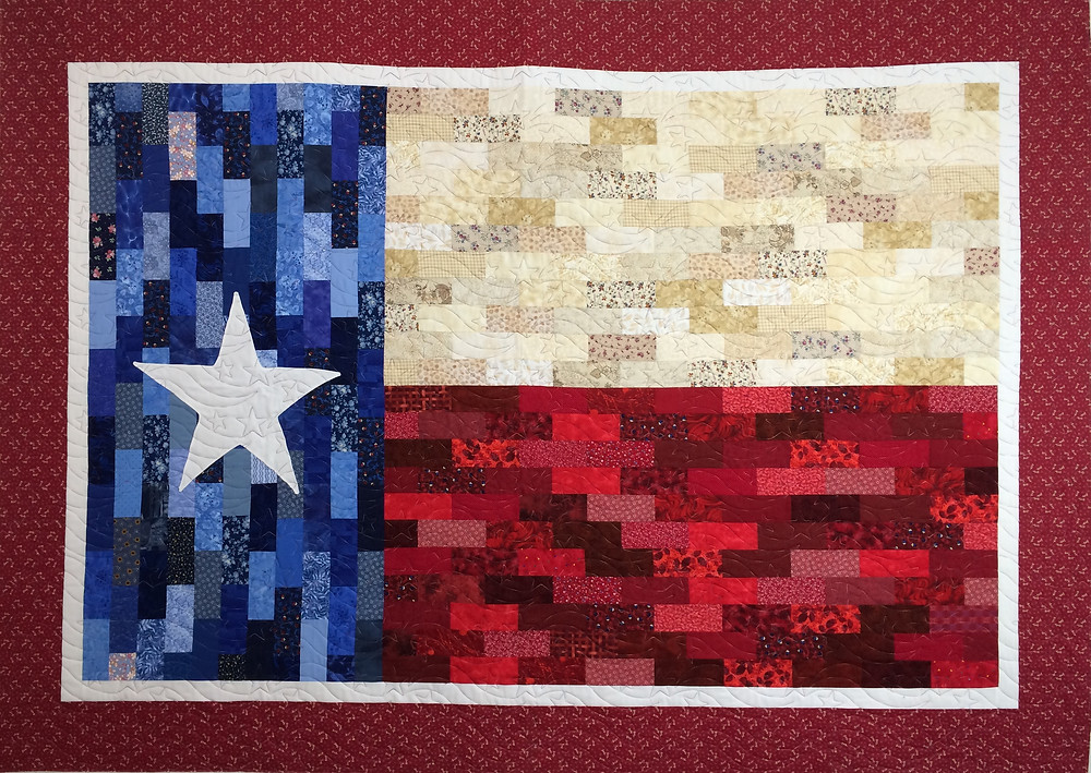 Texas Flag quilt with strip piecing of red, white and blue fabrics